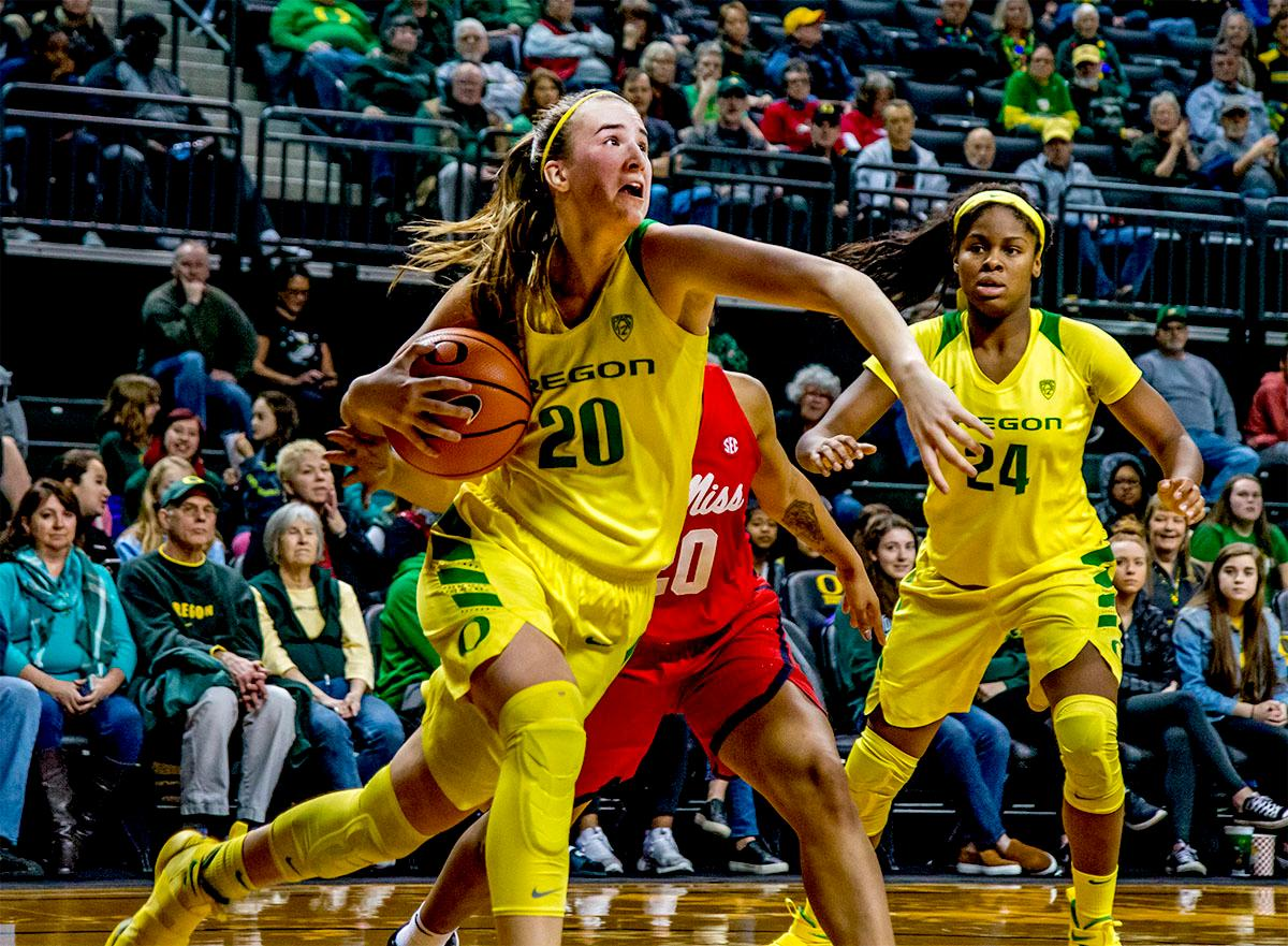 The Duck's Sabrina Ionescu (#20) makes a run under the basket for a shot. The Duck's Sabrina Ionescu (#20) is introduced at the start of the game against the Ole Miss Rebels. The Oregon Ducks womens basketball team defeated the Ole Miss Rebels 90-46 on Sunday at Matthew Knight Arena. Sabrina Ionescu tied the NCAA record for triple-doubles, finishing the game with 21 points, 14 assists, and 11 rebounds. Ruthy Hebard added 16 points, Satou Sabally added 12, and both Lexi Bando and Maite Cazorla scored 10 each. The Ducks will next face off against Texas A&M on Thursday Dec. 21 and Hawaii on Friday Dec. 22 in Las Vegas for Duel in the Desert before the start of Pac-12 games. Photo by August Frank, Oregon News Lab