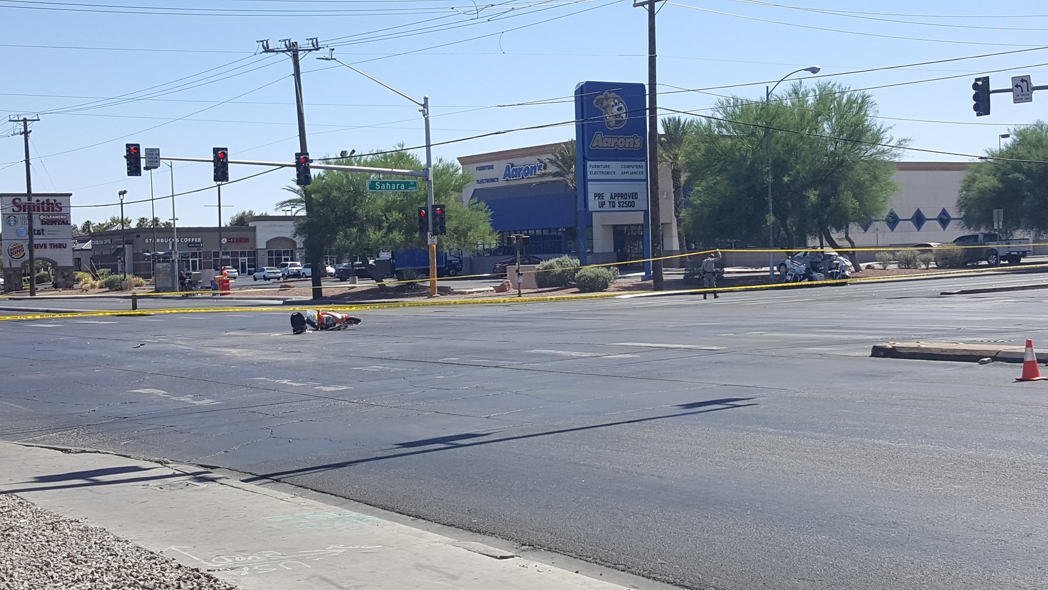 Police say a moped rider ran a red light and collided with a cement truck at Sahara and Nellis. (Christy Wilcox | KSNV)