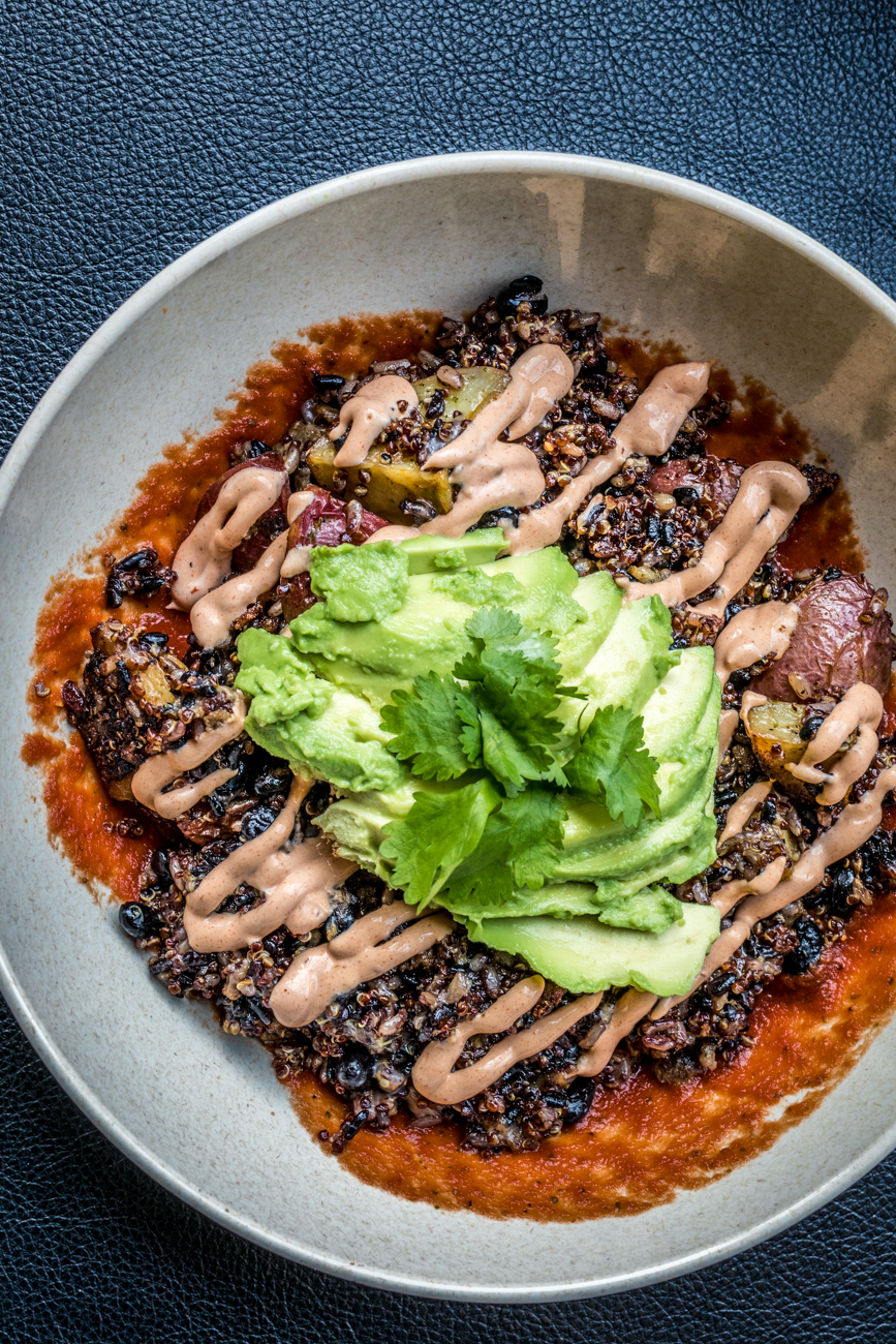 The Sol Bowl: quinoa, rice, chorizo, black beans, potatoes, chimichurri, salsa, cheddar, avocado, cilantro, and chipotle crema / Image: Catherine Viox{ }// Published: 2.10.20