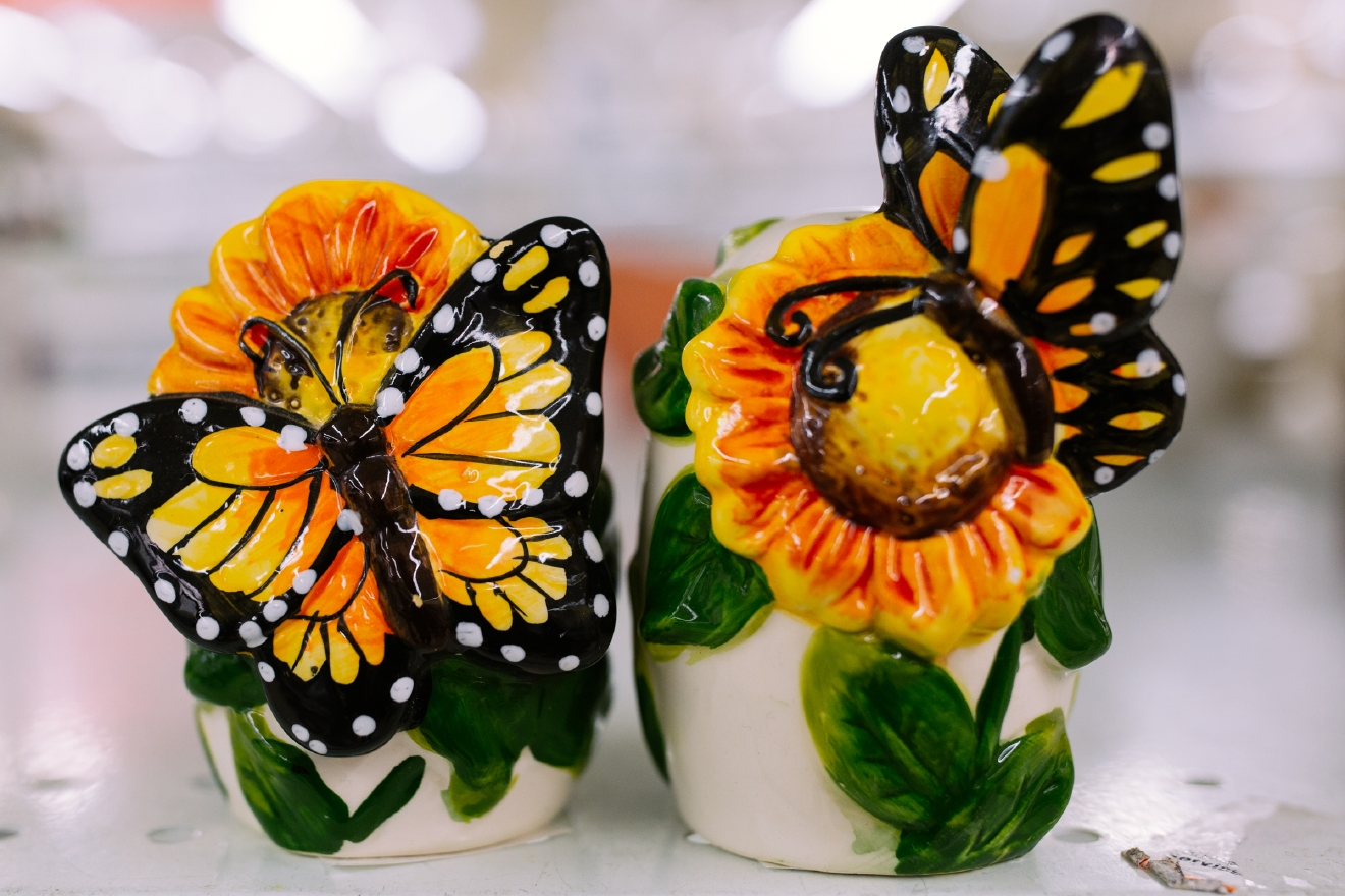 Butterfly salt and pepper shakers. $1.99 each  Are you going to a White Elephant Gift Exchange this year? We headed to our local Value Village to give you some gift ideas and how much they cost. (Image: Joshua Lewis / Seattle Refined)