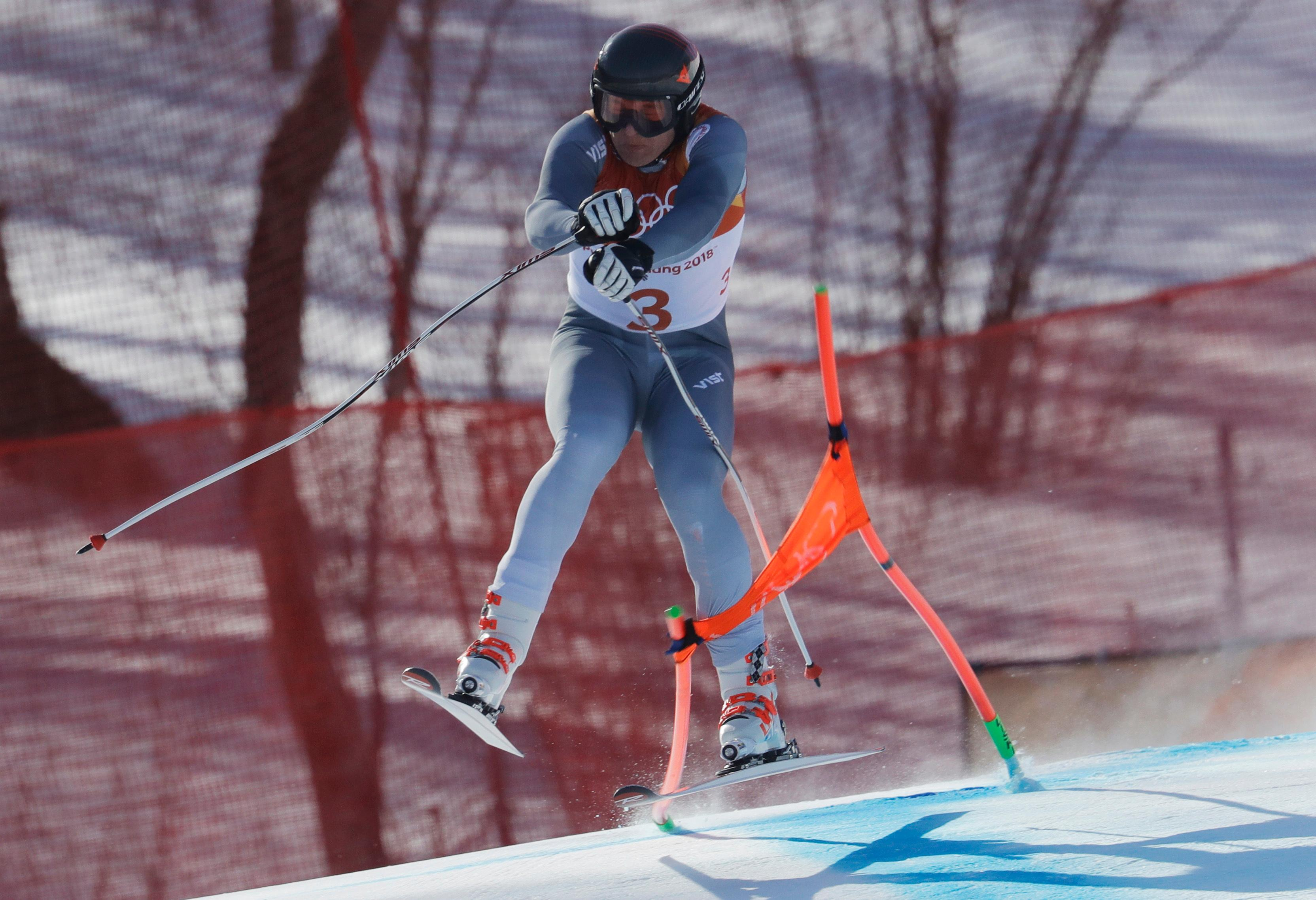 Russia's Pavel Trikhichev crashes during the downhill portion of the men's combined at the 2018 Winter Olympics in Jeongseon, South Korea, Tuesday, Feb. 13, 2018. (AP Photo/Michael Probst)