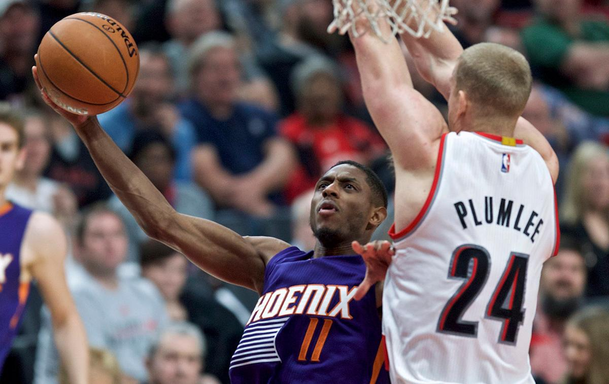 Phoenix Suns guard Brandon Knight shoots in front of Portland Trail Blazers forward Mason Plumlee during the second half of an NBA basketball game in Portland, Ore., Tuesday, Nov. 8, 2016. (AP Photo/Craig Mitchelldyer)