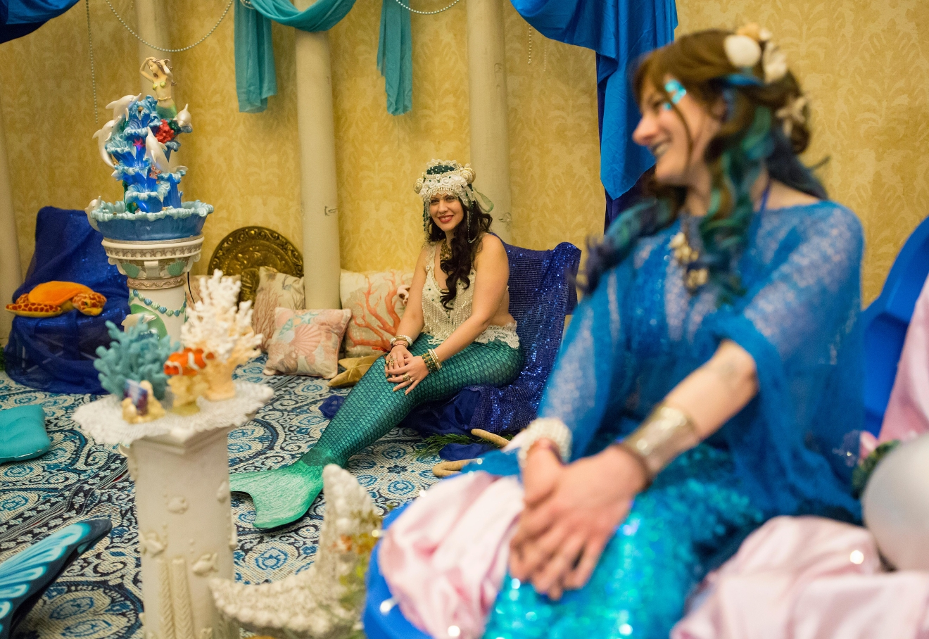 Una the Mermaid of The Traveling Fanta-Sea Cove sits with her fellow mer-people at Mythicworlds Convention and Masquerades. (Sy Bean / Seattle Refined)