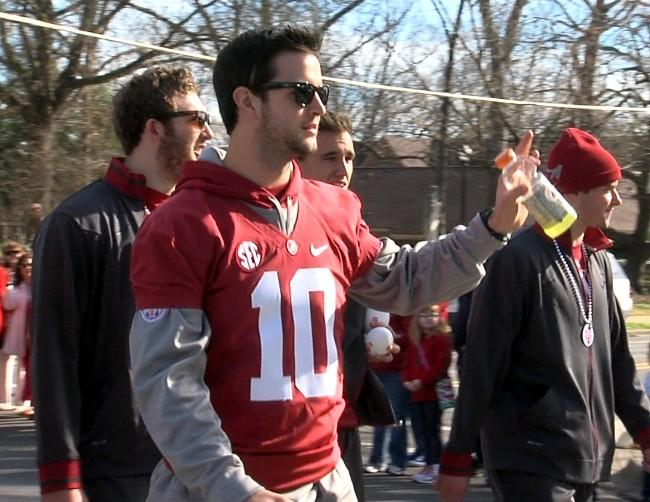 Alabama quarterback AJ McCarron waves to the fans during the BCS National Championship parade on Saturday, January 19, 2013.