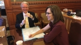 Lawmaker gives flu shots at state capitol