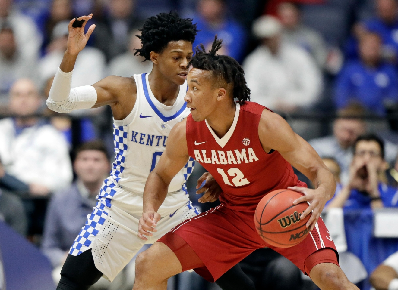 Alabama guard Dazon Ingram (12) is guarded by Kentucky's De'Aaron Fox (0) in the first half of an NCAA college basketball game in the semifinals of Southeastern Conference tournament Saturday, March 11, 2017, in Nashville, Tenn. AP Photo/Wade Payne)