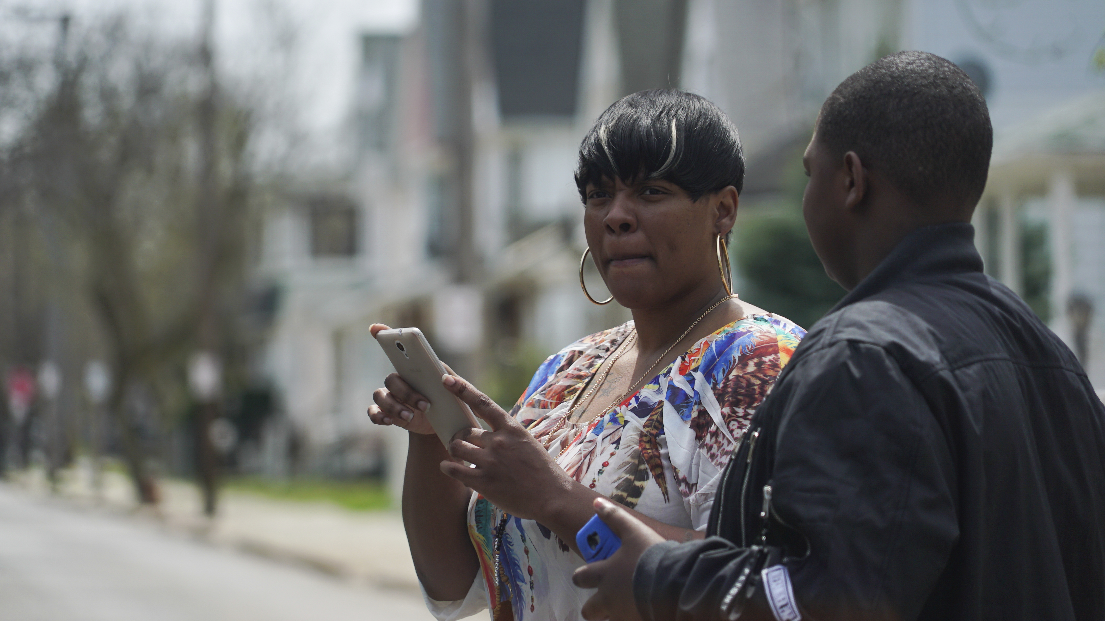 Alexis Lee, a childhood friend of Steve Stephens, speaks with a neighbor near Stephens' childhood home in Cleveland, Ohio, Monday, April 17, 2017. Authorities in Cleveland have expanded their manhunt nationwide for Stephens, a man suspected of gunning down a retiree and posting a video of the crime on Facebook. (AP Photo/Dake Kang)