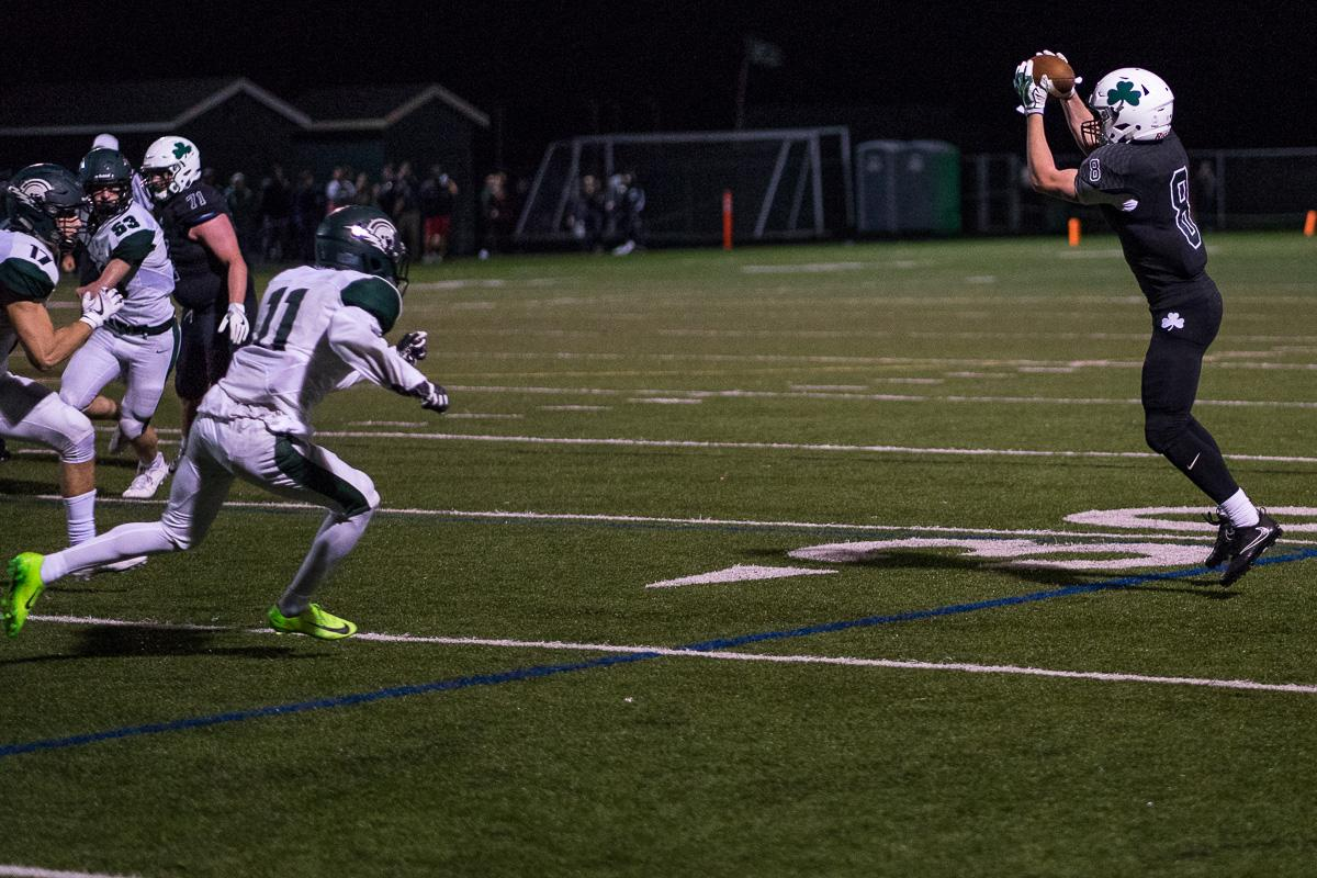Sheldon's Matthew Burgess (#8) completes a reception. On a rainy Monday evening, Sheldon defeated West Salem at home 41 – 7. The game had been postponed until Monday, September 18, due to unhealthy levels of smoke in the air caused by nearby forest fires. Photo by Kit MacAvoy, Oregon News Lab
