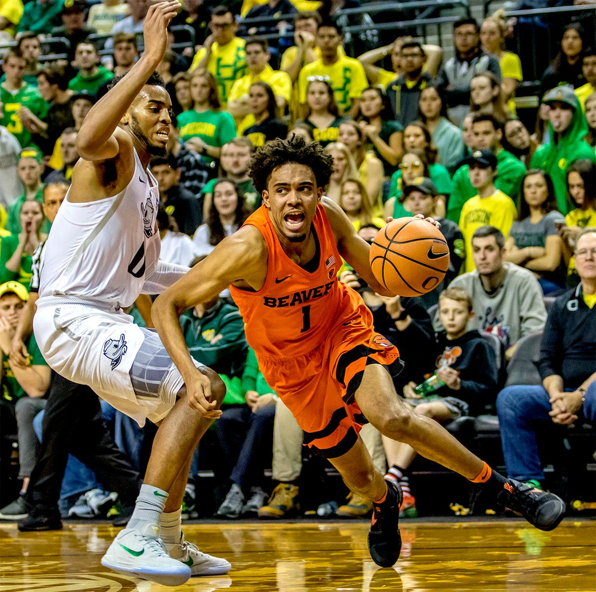 The Beaver's Stephen Thompson Jr. (#1) makes a run for the basket. The Ducks defeated the Beavers in the civil war game, 66-57, at Matthew Knight Arena on Saturday night. Elijah Brown scored a game high of 20 points with 18 of the points coming in the first half, Paul White added 17 points. The Ducks are now 14-7 overall and 4-4 in conference play. The Ducks will next face California on Thursday Feb. 1 at 6:00 p.m. Photo by August Frank, Oregon News Lab