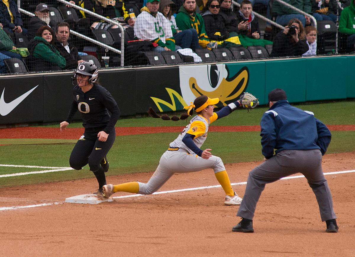 Oregon Ducks Danica Mercado (#2) is caught out by Cal's third base player Kobie Pettis (#21). The Ducks defeated Cal 2-1 in the second game of the three-game series. Photo by Dan Morrison, Oregon News Lab.