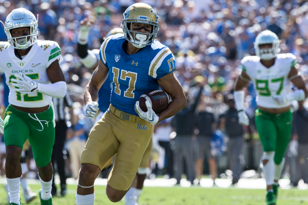 UCLA wide receiver Christian Pabico (#17) runs a caught pass in for a touchdown. The Oregon Ducks rallied during the second quarter to go into halftime tied 14-14 with the UCLA Bruins at Rose Bowl Stadium in Pasadena, California. Photo by Austin Hicks, Oregon News Lab