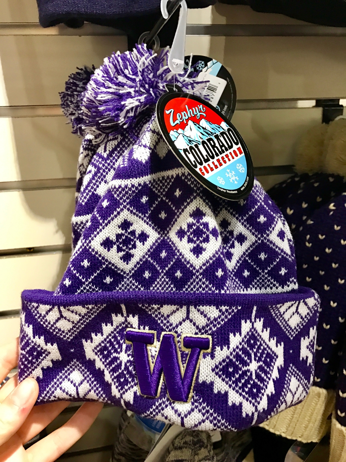 UW Beanie - $24.99                                          Whether you're a current student, alum, or just *love* the Dawgs, it's a pretty exciting time to be a Husky fan right now. Just to catch you up, the University of Washington football team is having one of their best seasons in years, and will be playing the Peach Bowl in Atlanta on December 31st. If you know a Dawg fan, they're probably salivating at the mouth right about now. Which is why it's a perfect time to give them a themed gift! Here are some of the coolest Husky gear we saw at the University Bookstore on the Avenue during our last visit. Pro Tip: They're open 10 a.m. - 7 p.m. on Christmas Eve! (Image: Britt Thorson / Seattle Refined)