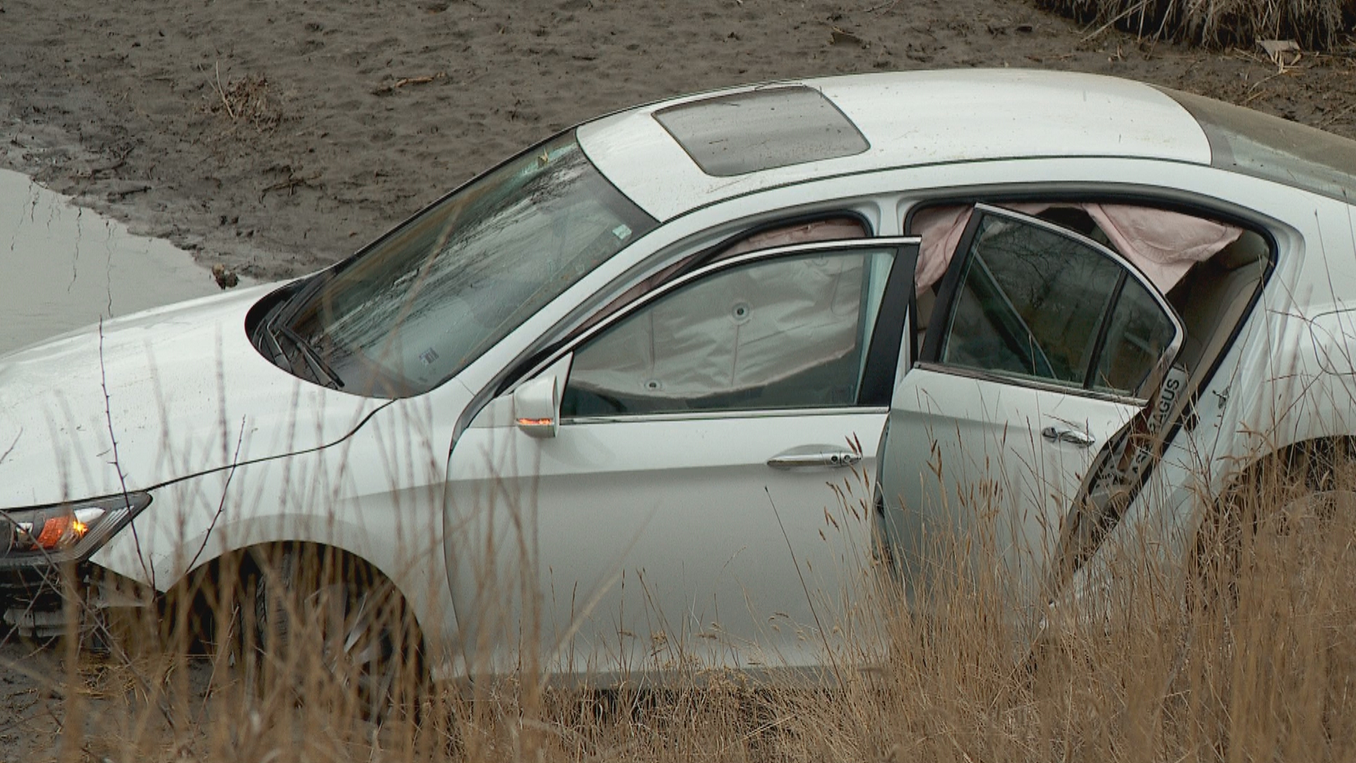 A vehicle with only one occupant drove into a retention pond Friday morning at 617 West 11400 S. Police say medical condition motorist responsible. (Photo: Kurt Smith / KUTV)<p></p>