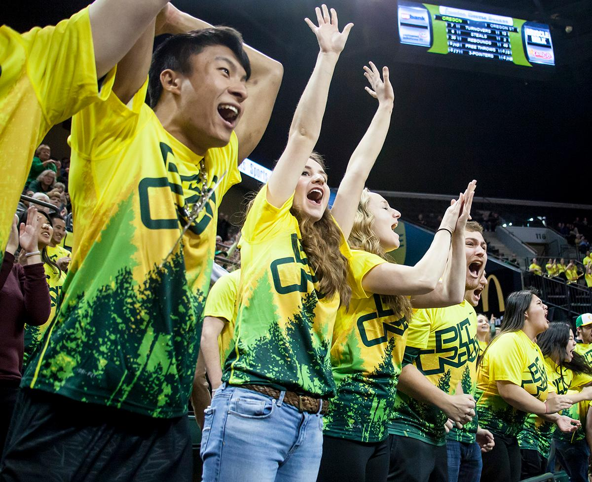 The Pit Crew cheer on the Oregon Ducks towards the end of Friday night's close game. The Oregon Ducks lost 40 to 43 against the Oregon State Beavers after a tightly matched 4th quarter. Photo by Ben Lonergan, Oregon News Lab
