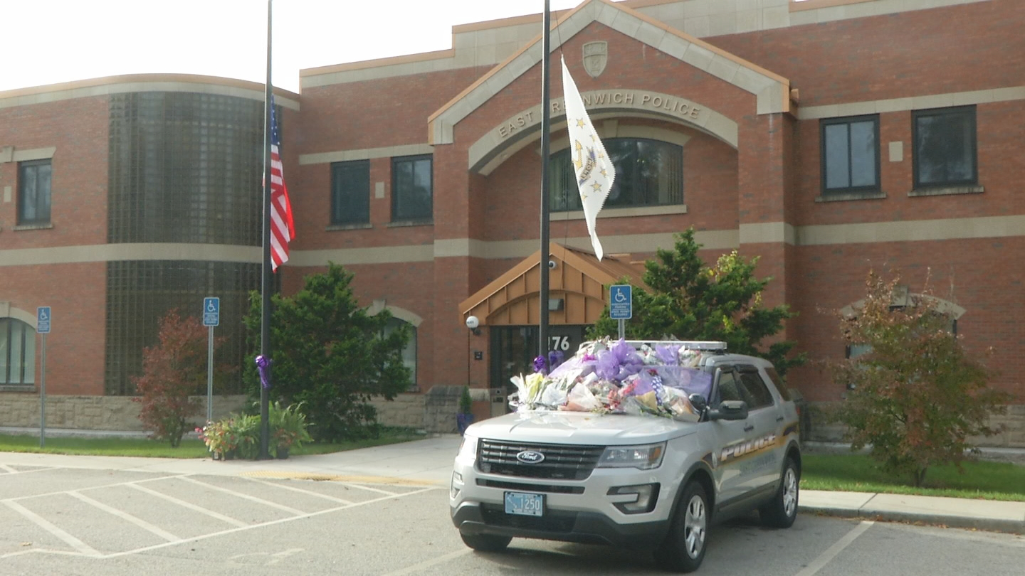 Purple decorations are placed on an East Greenwich police cruiser. (WJAR)<p></p>