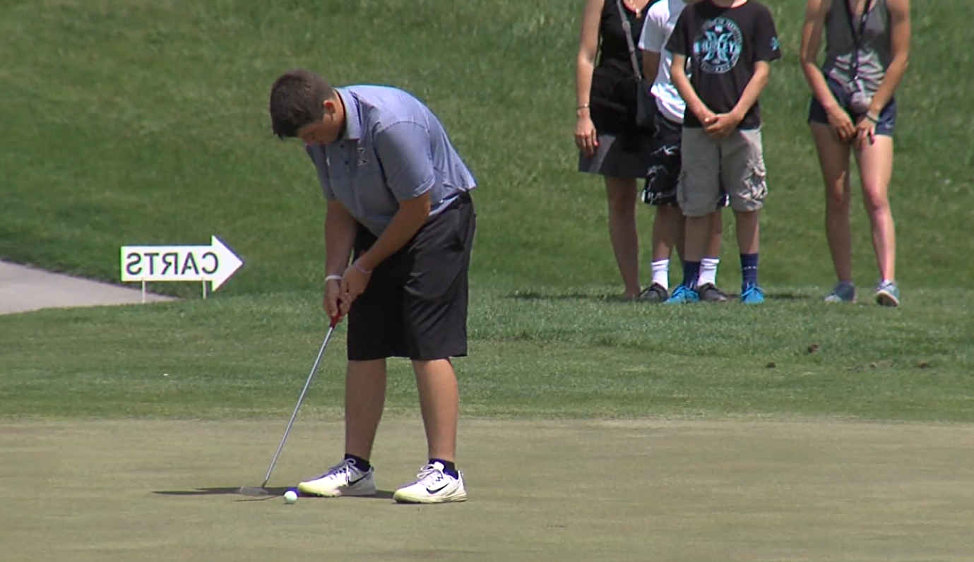 Kearney High junior Maverick Widdowson putts for, and makes, his par on the 5th at Meadowlark Hills on May 15, 2017 (NTV News)