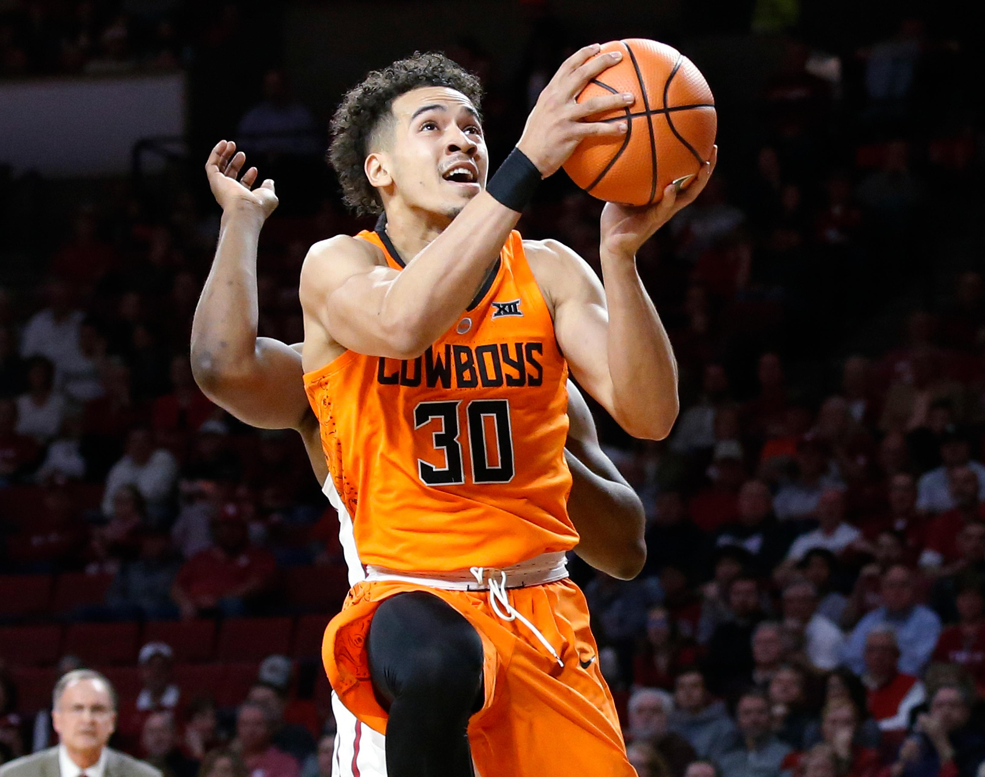Oklahoma State guard Jeffrey Carroll (30) shoots during the first half of the team's NCAA college basketball game against Oklahoma in Norman, Okla., Wednesday, Jan. 3, 2018. (AP Photo/Sue Ogrocki)