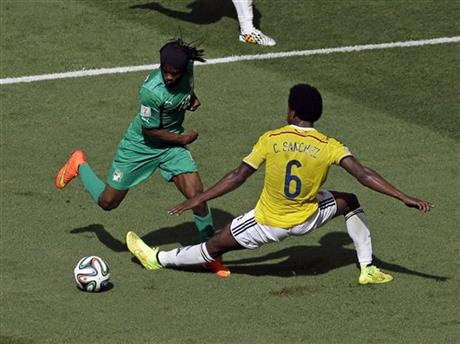 Ivory Coast's Gervinho dribbles past Colombia's Carlos Sanchez Moreno before scoring during the group C World Cup soccer match between Colombia and Ivory Coast at the Estadio Nacional in Brasilia, Brazil, Thursday, June 19, 2014.