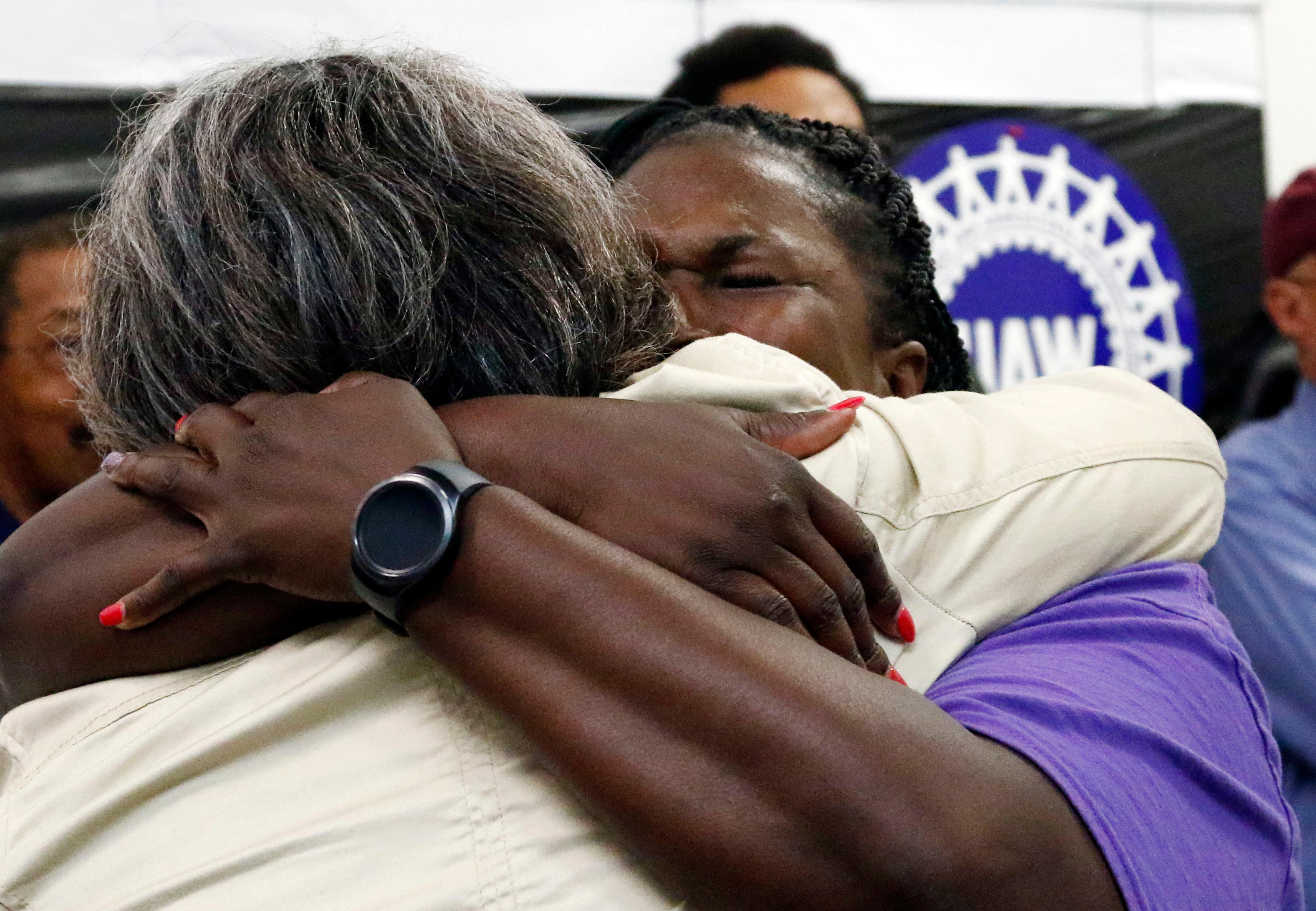 United Auto Workers members, some Nissan employees and supporters console one another as they express their disappointment at losing their bid to form a union at the Nissan vehicle assembly plant in Canton, Miss., Friday, Aug. 4, 2017.  (AP Photo/Rogelio V. Solis)