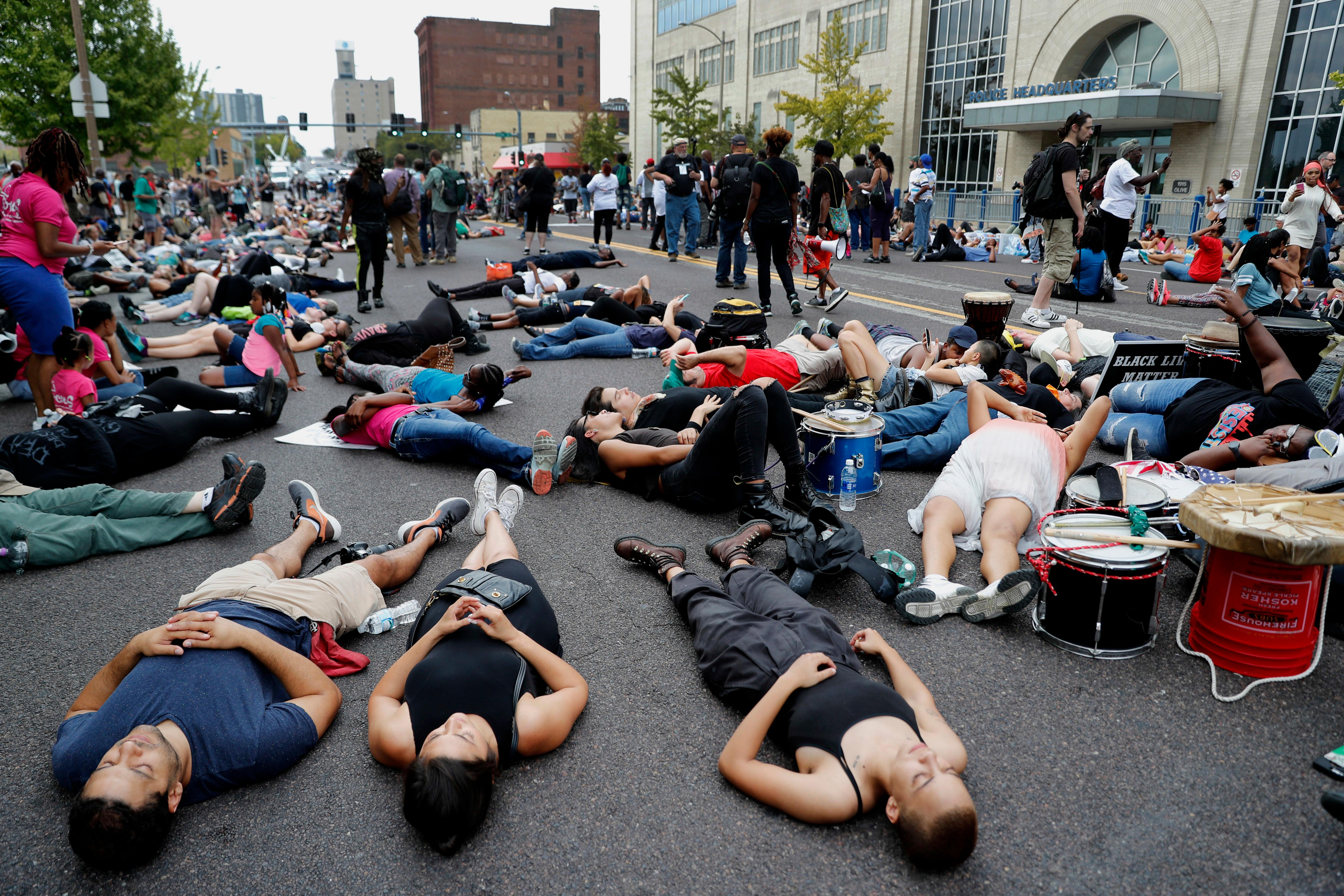 "Demonstrators participate in a ""die-in"" protest outside the St. Louis Police Department headquarters in response to a not guilty verdict in the trial of former St. Louis police officer Jason Stockley Sunday, Sept. 17, 2017, in St. Louis. Stockley was acquitted on Friday in the 2011 killing of a black man following a high-speed chase. (AP Photo/Jeff Roberson)"