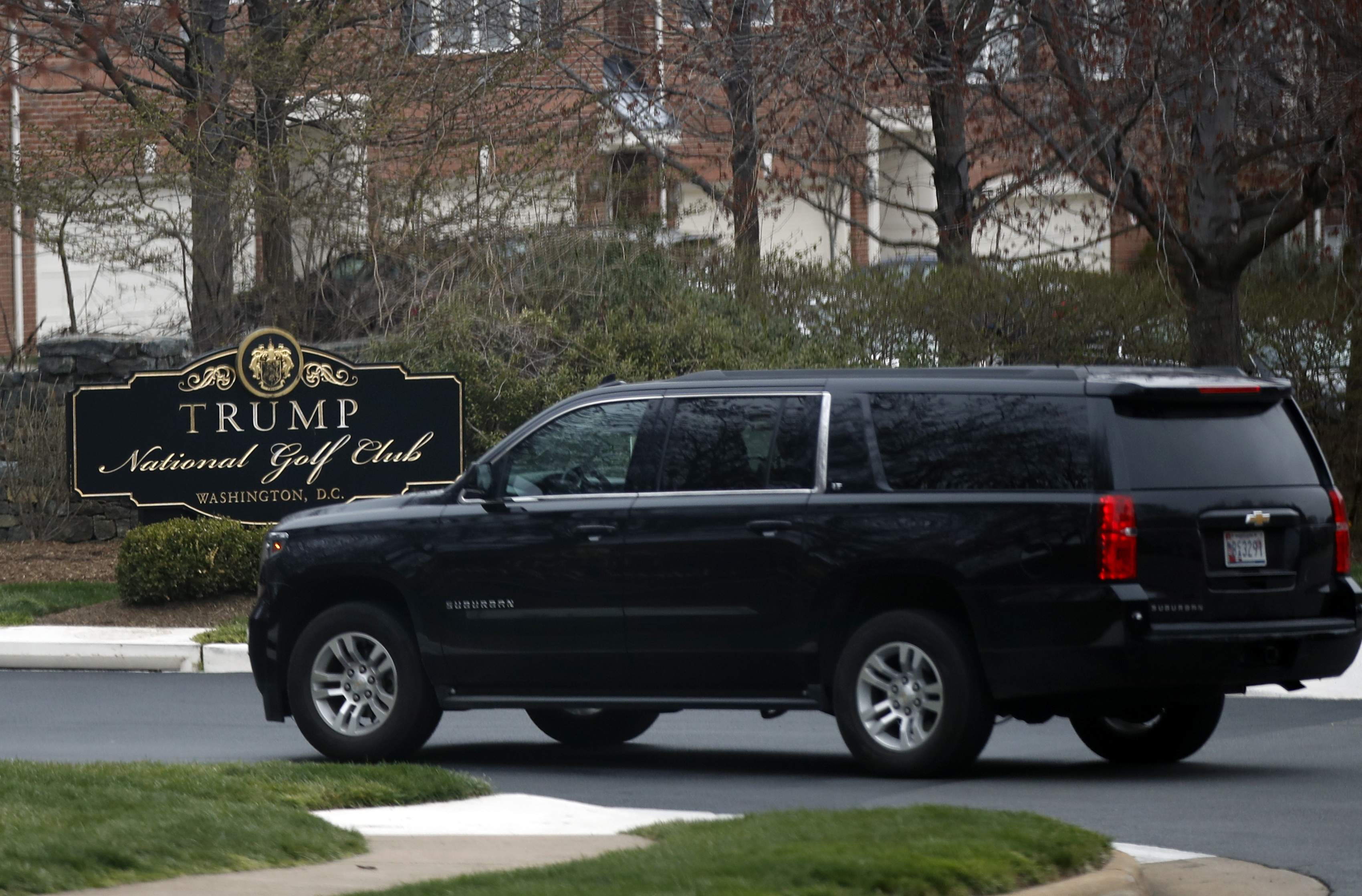 DAY 66 - In this March 26, 2017, file photo, a vehicle with President Donald Trump's motorcade enters the Trump National Golf Club in Potomac Falls, Va. The president traveled to his golf club in Virginia but there were no events open for press coverage and was not photographed. (AP Photo/Manuel Balce Ceneta, File)