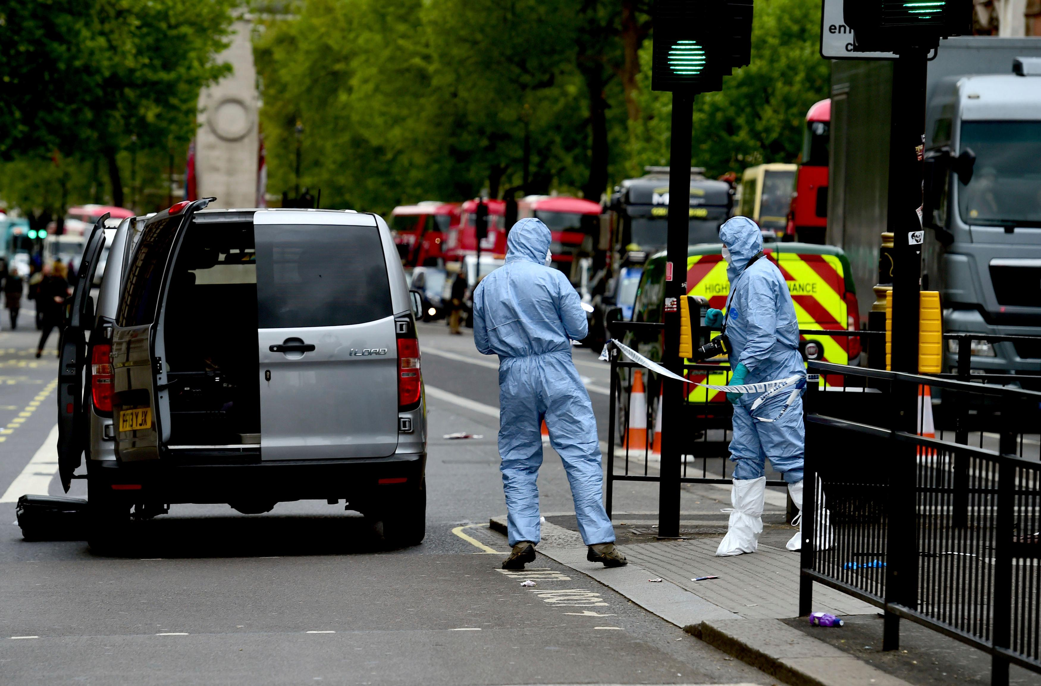 Police attend the scene after a person was arrested following an incident in Whitehall in London, Thursday April 27, 2017.  London police arrested a man for possession of weapons Thursday near Britain's Houses of Parliament. (Dominic Lipinski/PA via AP)