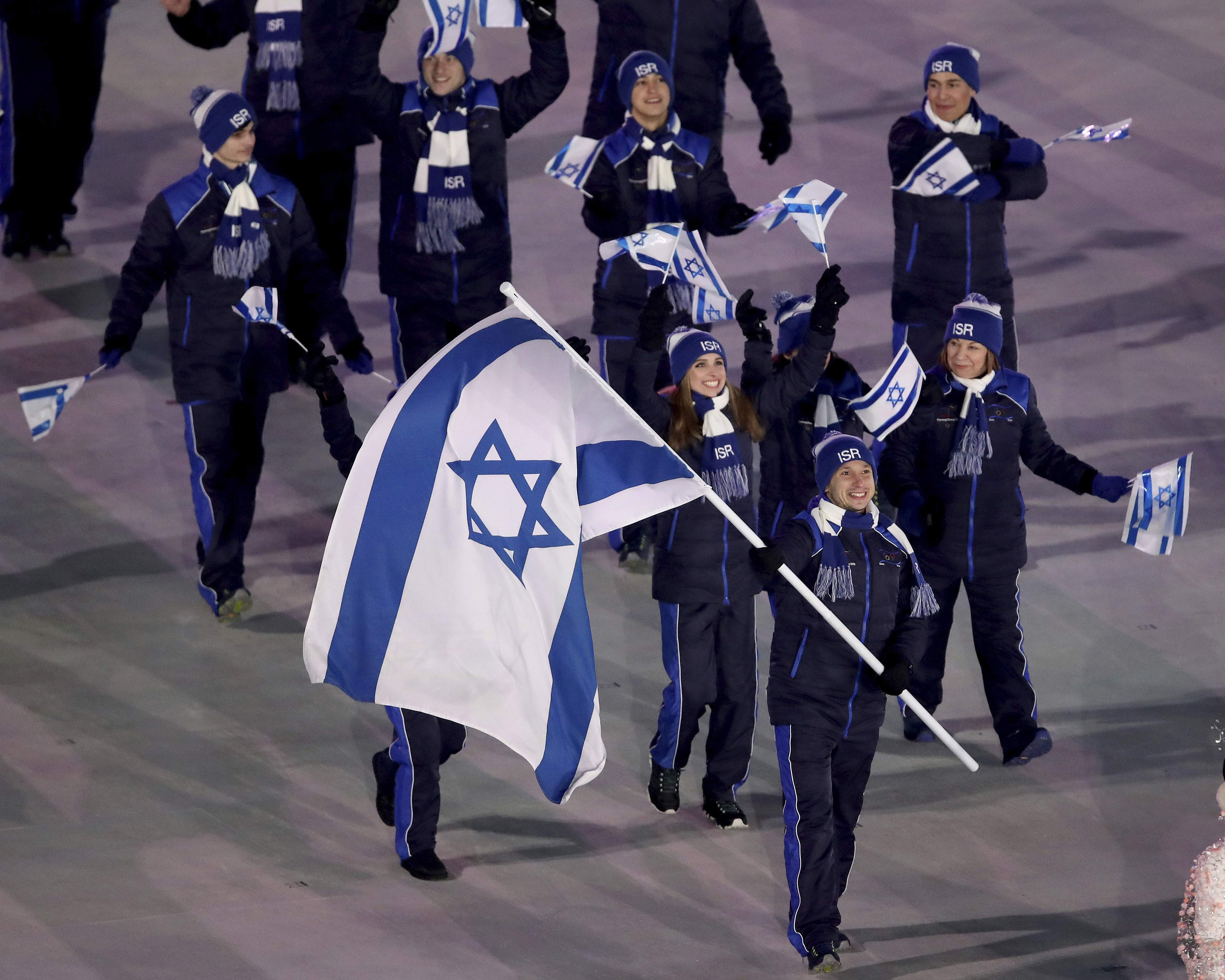 Alexei Bychenko carries the flag of Israel during the opening ceremony of the 2018 Winter Olympics in Pyeongchang, South Korea, Friday, Feb. 9, 2018. (Sean Haffey/Pool Photo via AP)