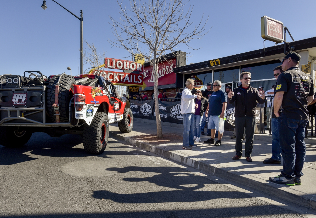 Drivers and crew gather for the opening party following the Mint 400 4 Wheel Parts Vehicle Procession powered by Odyssey Battery in downtown Las Vegas along Fremont Street East to kick off the Mint 400 off-road race weekend on Wednesday, Mar. 1, 2017. [Mark Damon/Las Vegas News Bureau]