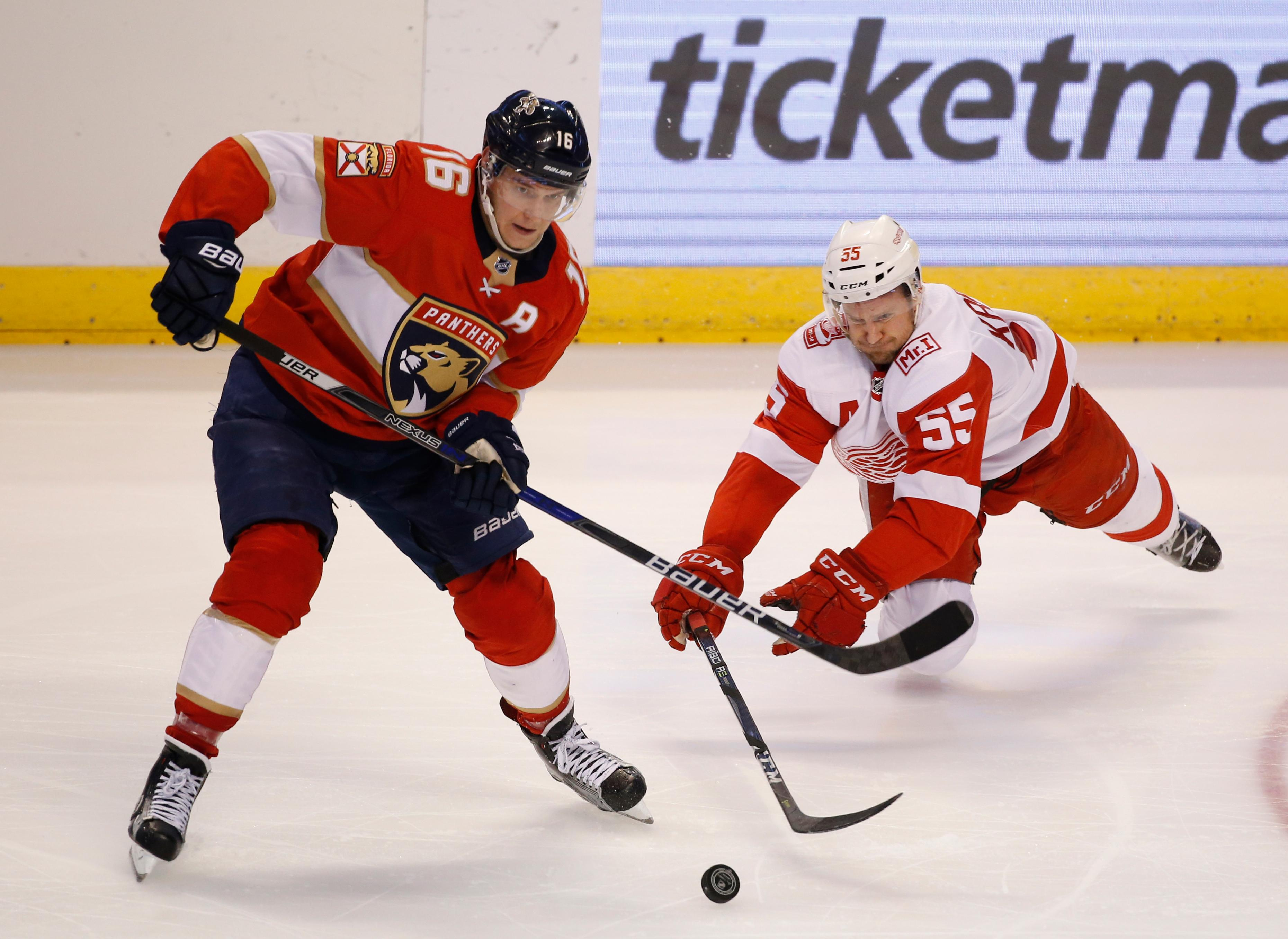 Florida Panthers center Aleksander Barkov (16) and Detroit Red Wings defenseman Niklas Kronwall (55) battle for the puck during the second period of an NHL hockey game, Saturday, Feb. 3, 2018 in Sunrise, Fla. (AP Photo/Wilfredo Lee)