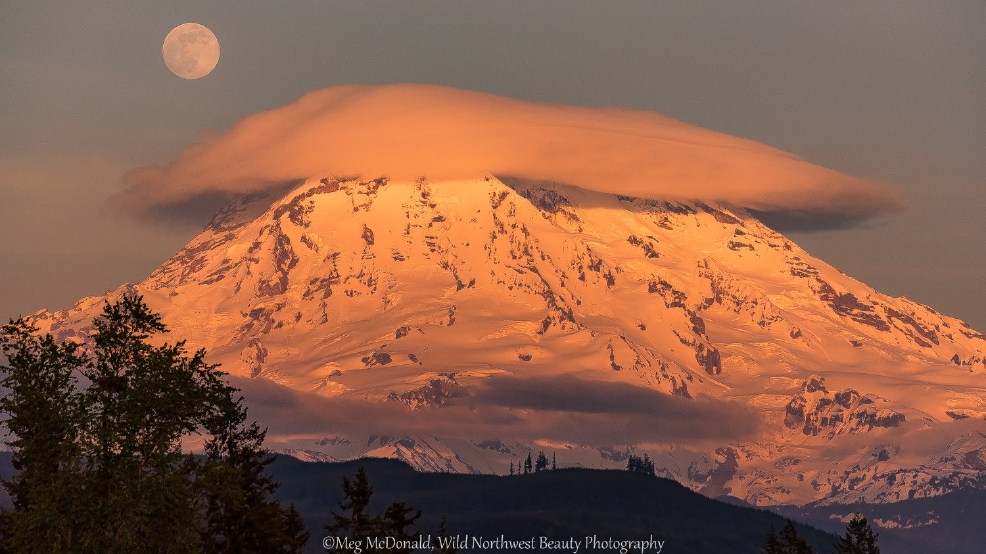 Watch: Lenticular clouds dance over Mt. Rainier as moon rises behind