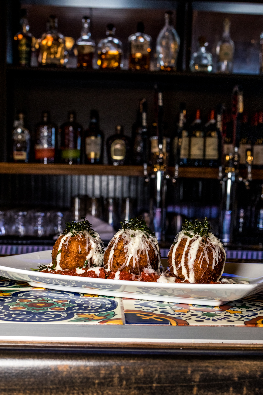 Arancini: fried risotto balls stuffed with mozzarella and prosciutto served with marinara and peppercorn ranch / Image: Catherine Viox{ }// Published: 4.21.20