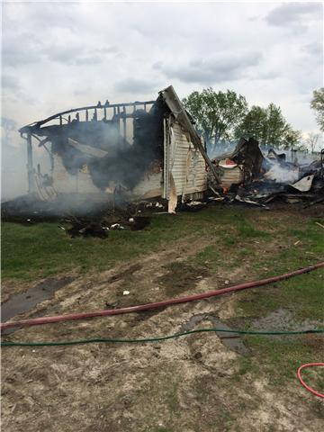 Fire crews responded to the home of Donald Schultz off Highway 156 on the east edge of South Gifford Thursday afternoon. (Photo by John Garlock)