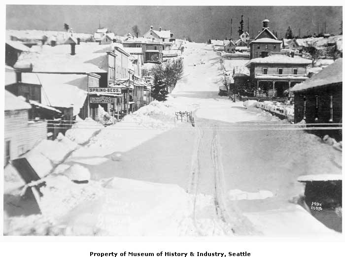 Over five feet of snow fell on Seattle in early January 1880. The city wasn't used to such heavy snow. Schools closed, trains didn't run, and the city's activities ground to a halt. This photo was taken on January 10th, 1880 after the great snow. It shows the view up Cherry Street from First Avenue towards First Hill. (Photo 1983.10.6267 // PEMCO Webster & Stevens Collection, Museum of History & Industry, Seattle)