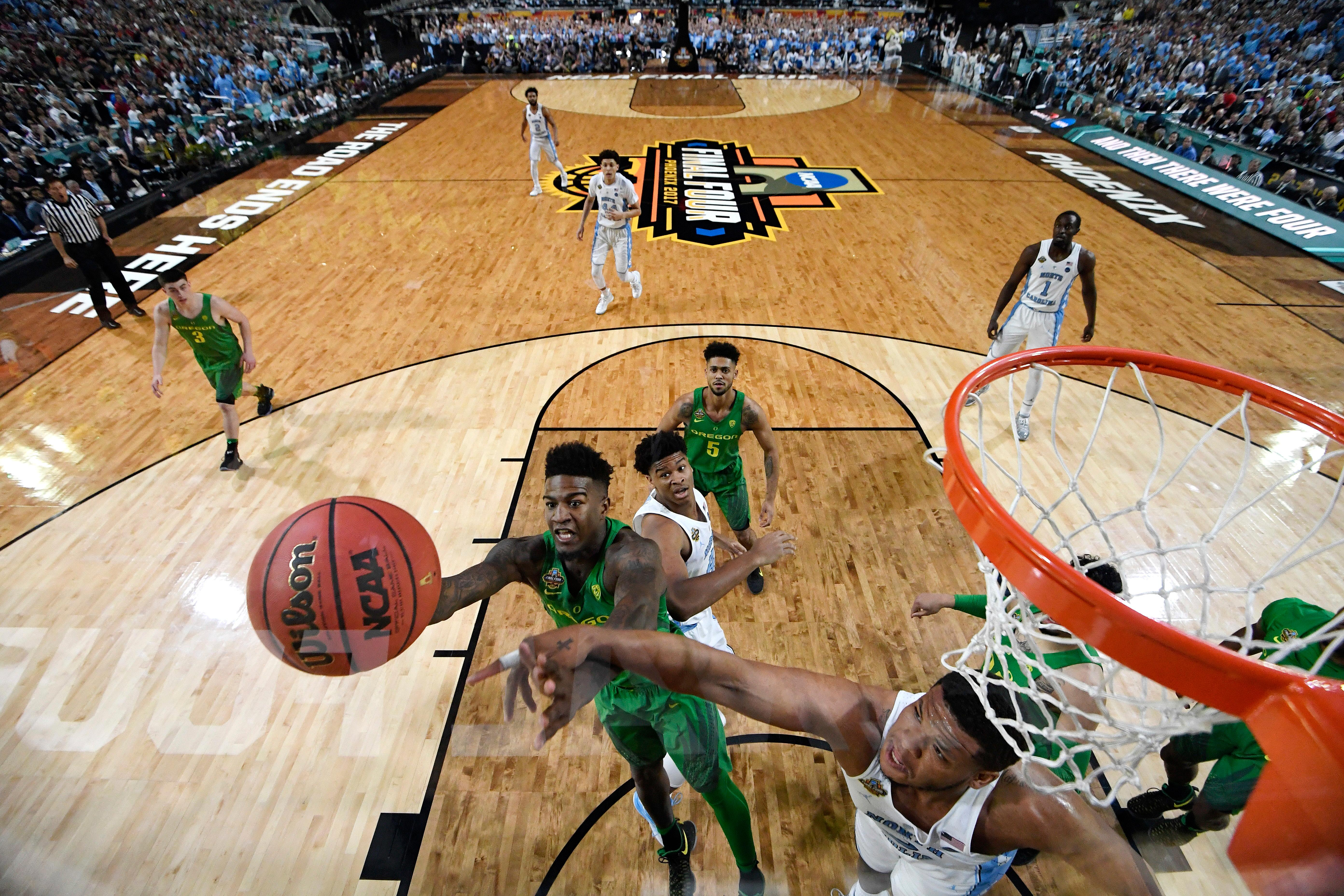 North Carolina's Kennedy Meeks, right, blocks a shot by Oregon's Jordan Bell during the first half in the semifinals of the Final Four NCAA college basketball tournament, Saturday, April 1, 2017, in Glendale, Ariz. (AP Photo/Chris Steppig, Pool)