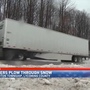 Truck drivers keep trucking through the snow