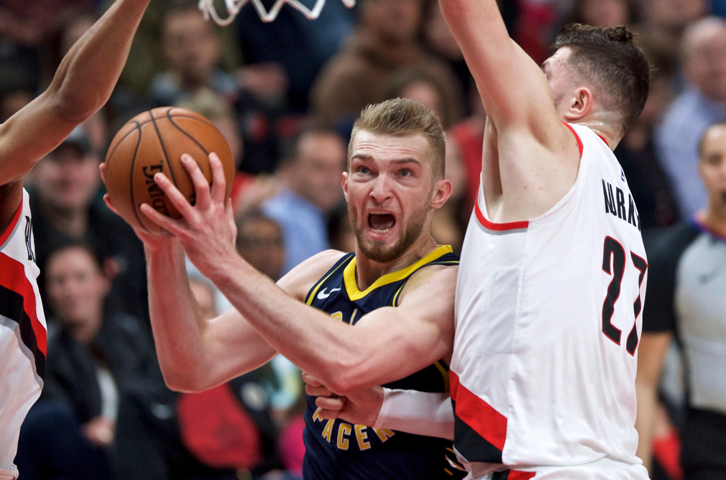 Indiana Pacers center Domantas Sabonis looks for a shot as Portland Trail Blazers center Jusuf Nurkic, right defends during the first half of an NBA basketball game in Portland, Ore., Thursday, Jan. 18, 2018. (AP Photo/Craig Mitchelldyer)