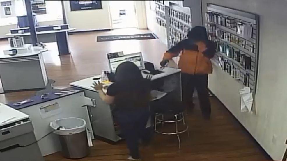 Surveillance Video Shows A Man Rob An Oklahoma City Metro PCS At Gunpoint.  (Oklahoma City Police Department)