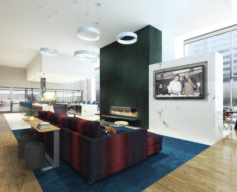 The Collection Lounge at The Danforth features modern decor with abundant natural light.