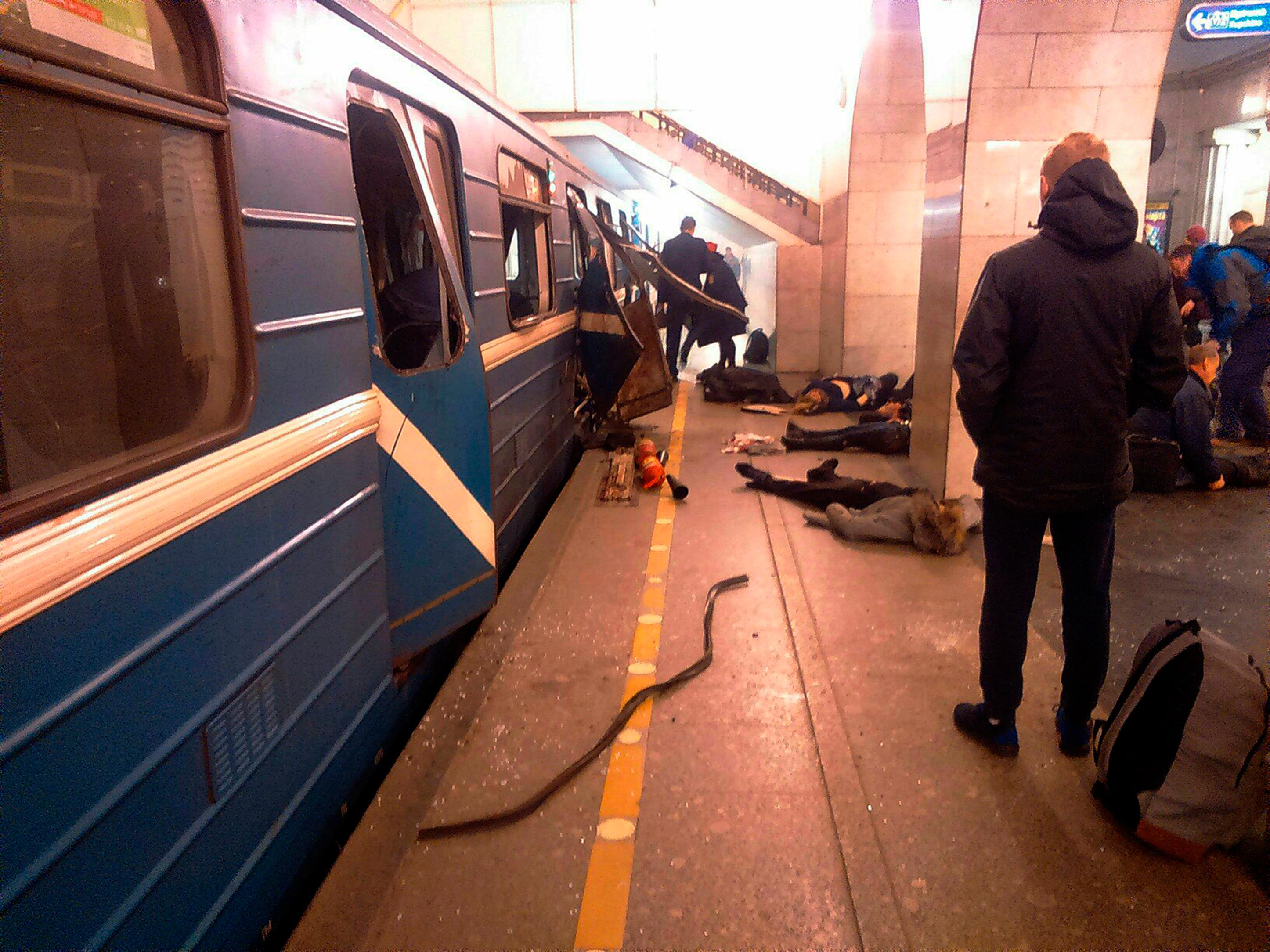 Blast victims lie near a subway train hit by a explosion at the Tekhnologichesky Institut subway station in St.Petersburg, Russia, Monday, April 3, 2017. The subway in the Russian city of St. Petersburg is reporting that several people have been injured in an explosion on a subway train. (AP Photo/DTP&ChP St. Peterburg via AP)