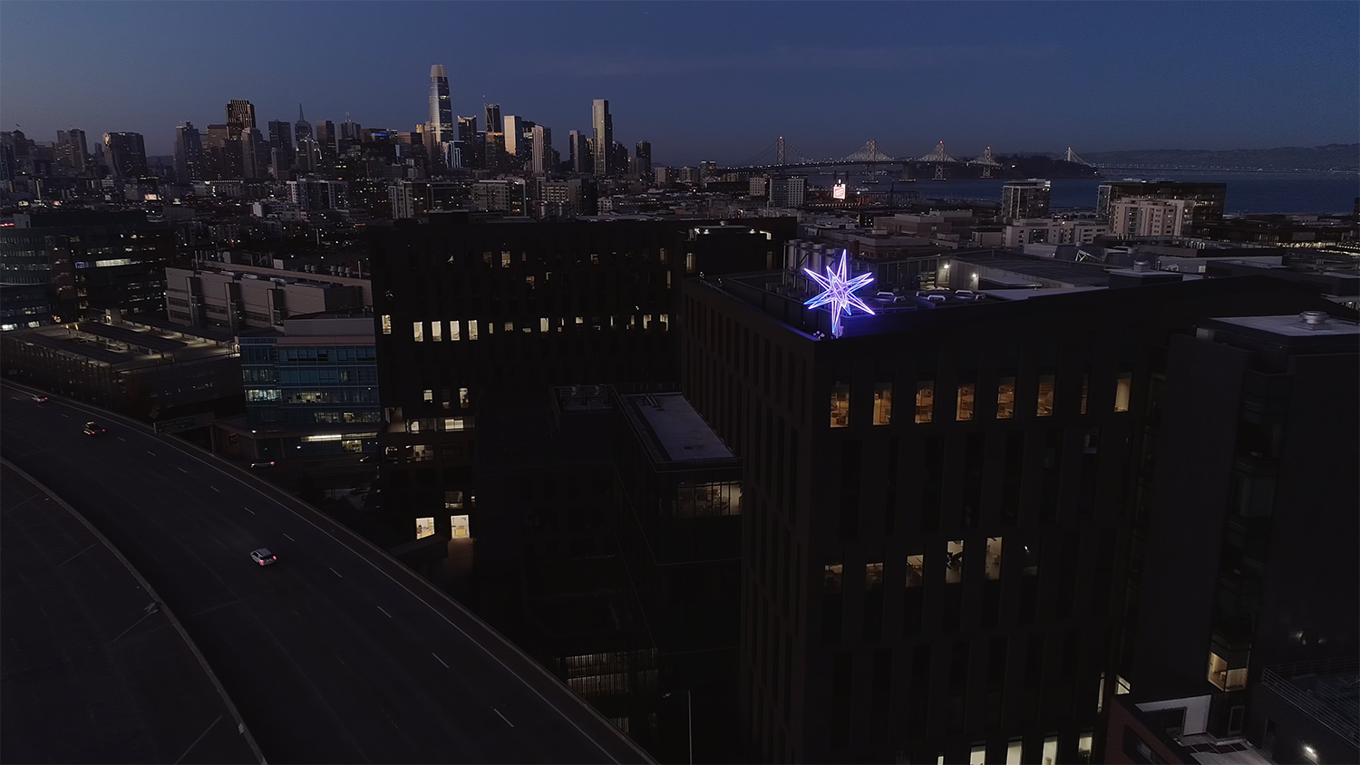 "Seattle's skyline has a new addition as of Tuesday night (12/8) - a 20-foot in diameter star installation beaming with 30,000 LED bulbs, located on top of the Kilroy Realty building at 333 Dexter Avenue N. The real estate development company placed four of these ""Kilroy Stars"" on high points in Seattle, San Francisco, San Diego and Los Angeles to unite the west coast, foster ""the sublime power of art within our communities"" and represent hope for 2021. The stars will shine in various rhythms, colors and patterns of light within 24-hour cycles. The installations will be up through the end of January.{&nbsp;}<a  href=""https://www.thekilroystars.com/"" target=""_blank"" title=""https://www.thekilroystars.com/"">More info online.</a>{&nbsp;}(Image: Zoetic)"