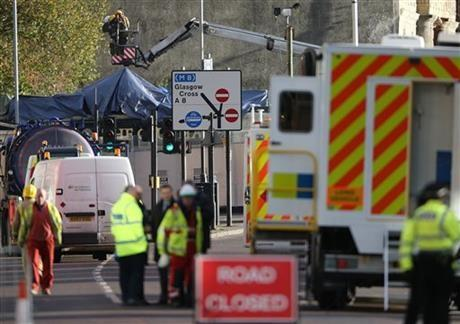 Police and Scottish Fire and Rescue services at the scene Saturday, Nov. 30, 2013, following the helicopter crash at the Clutha Bar in Glasgow, Scotland.