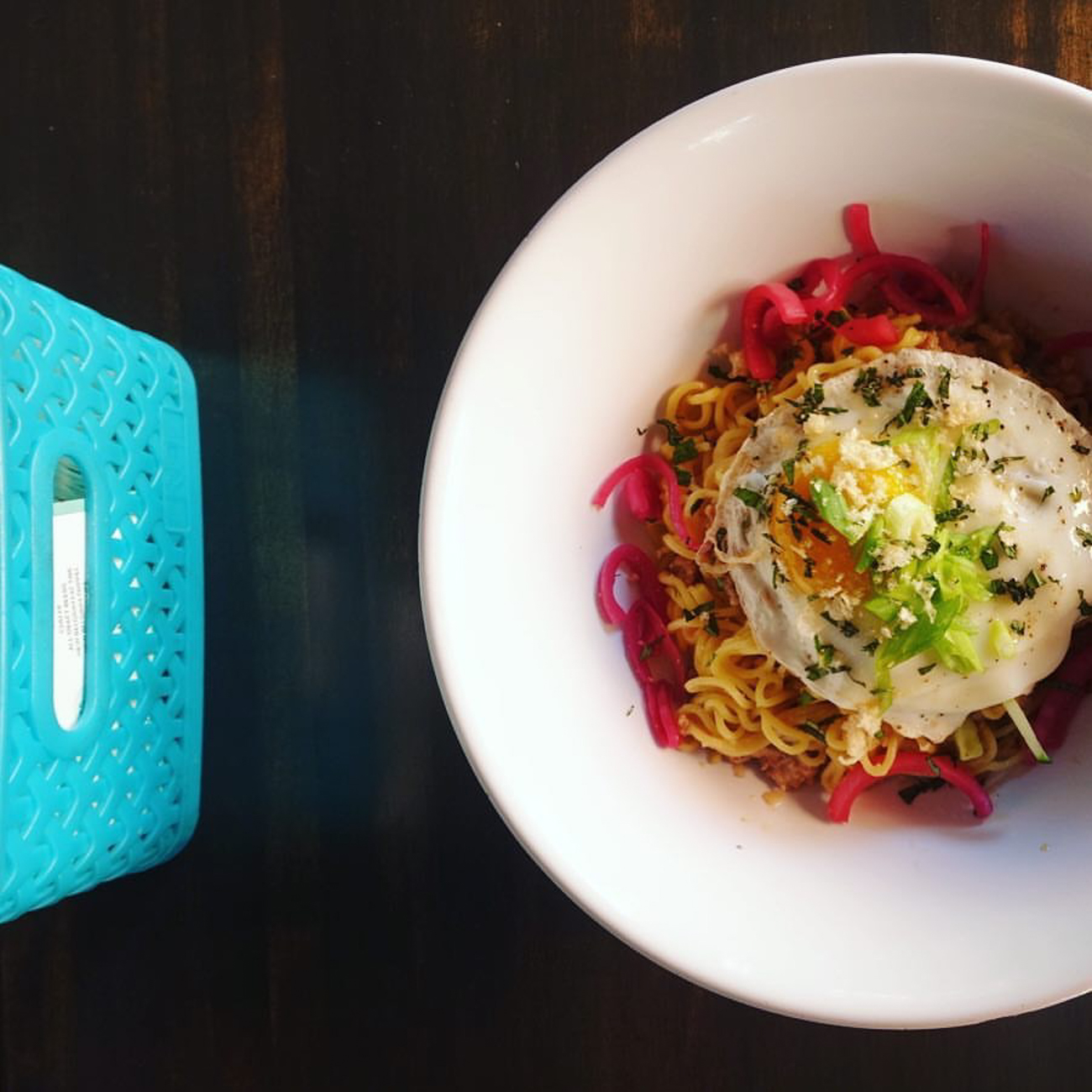 Miso Pork Mazemen: yakisoba noodles, fried egg, pickled red onions, green onions, cucumbers, thai basil, and chicharon garnish / Image courtesy of Quan Hapa // Published: 1.10.17