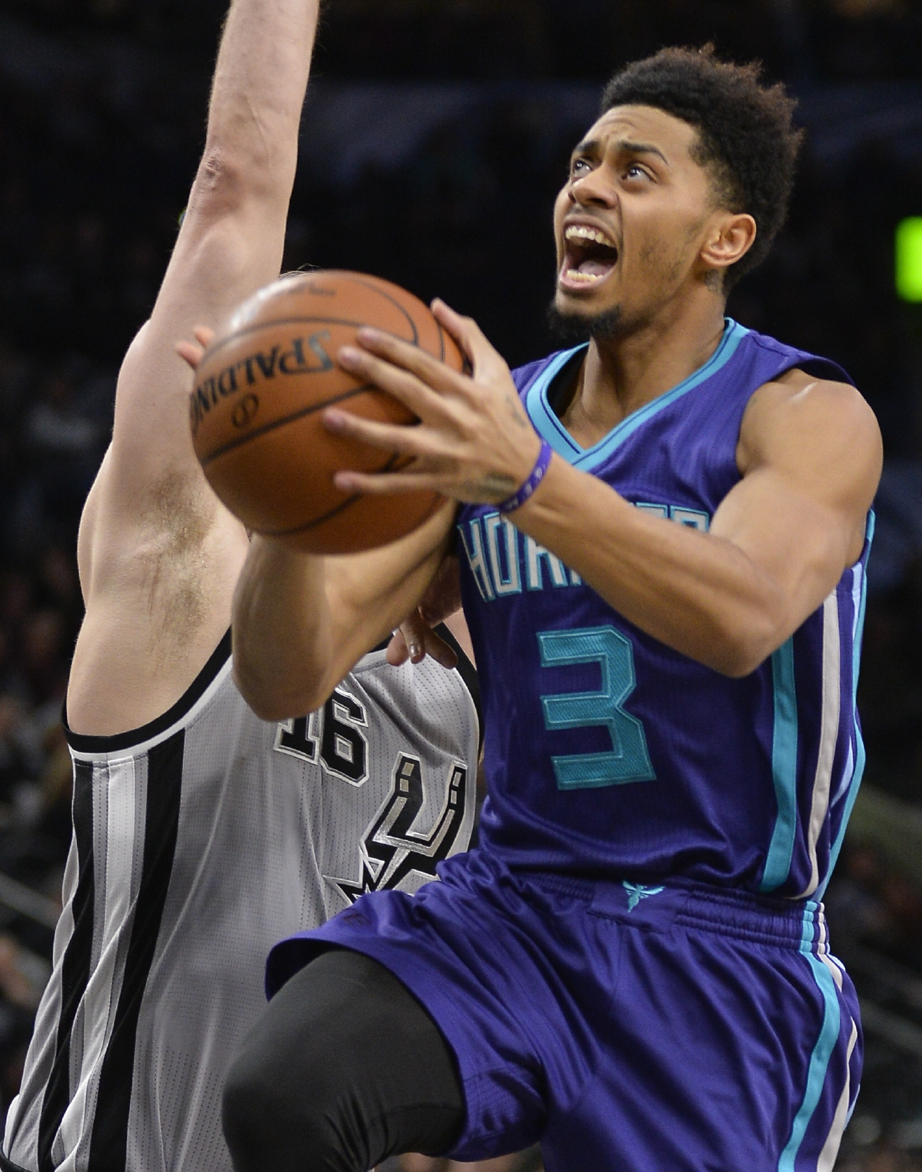 Charlotte Hornets guard Jeremy Lamb (3) shoots against San Antonio Spurs center Pau Gasol, of Spain, during the first half of an NBA basketball game, Saturday, Jan. 7, 2017, in San Antonio. (AP Photo/Darren Abate)