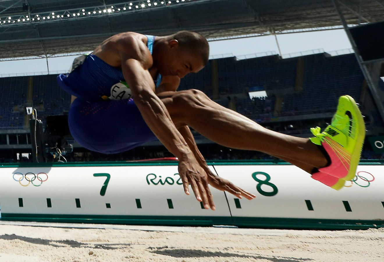 United States' Ashton Eaton makes an attempt in the long jump of the decathlon during the athletics competitions of the 2016 Summer Olympics at the Olympic stadium in Rio de Janeiro, Brazil, Wednesday, Aug. 17, 2016. (AP Photo/Matt Dunham)