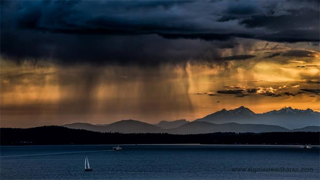 Weeping Clouds! Crazy rain clouds over Elliott Bay this evening. (Photo: Sigma Sreedharan Photography)