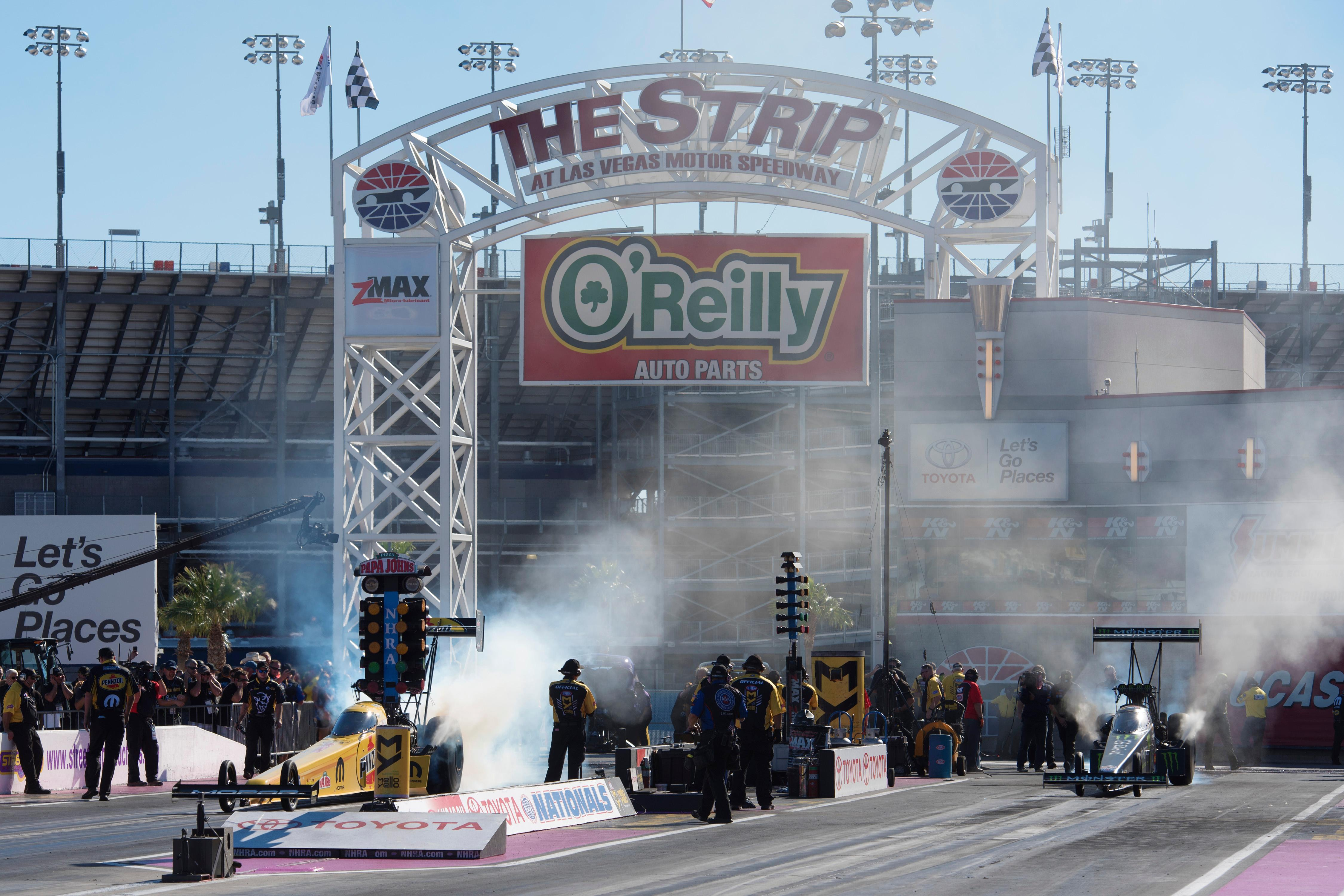 Top Fuel drivers Leah Pritchett, left, and Brittany Force smoke their tires before a run at the NHRA Toyota Nationals Sunday, October 29, 2017, at The Strip at the Las Vegas Motor Speedway. CREDIT: Sam Morris/Las Vegas News Bureau