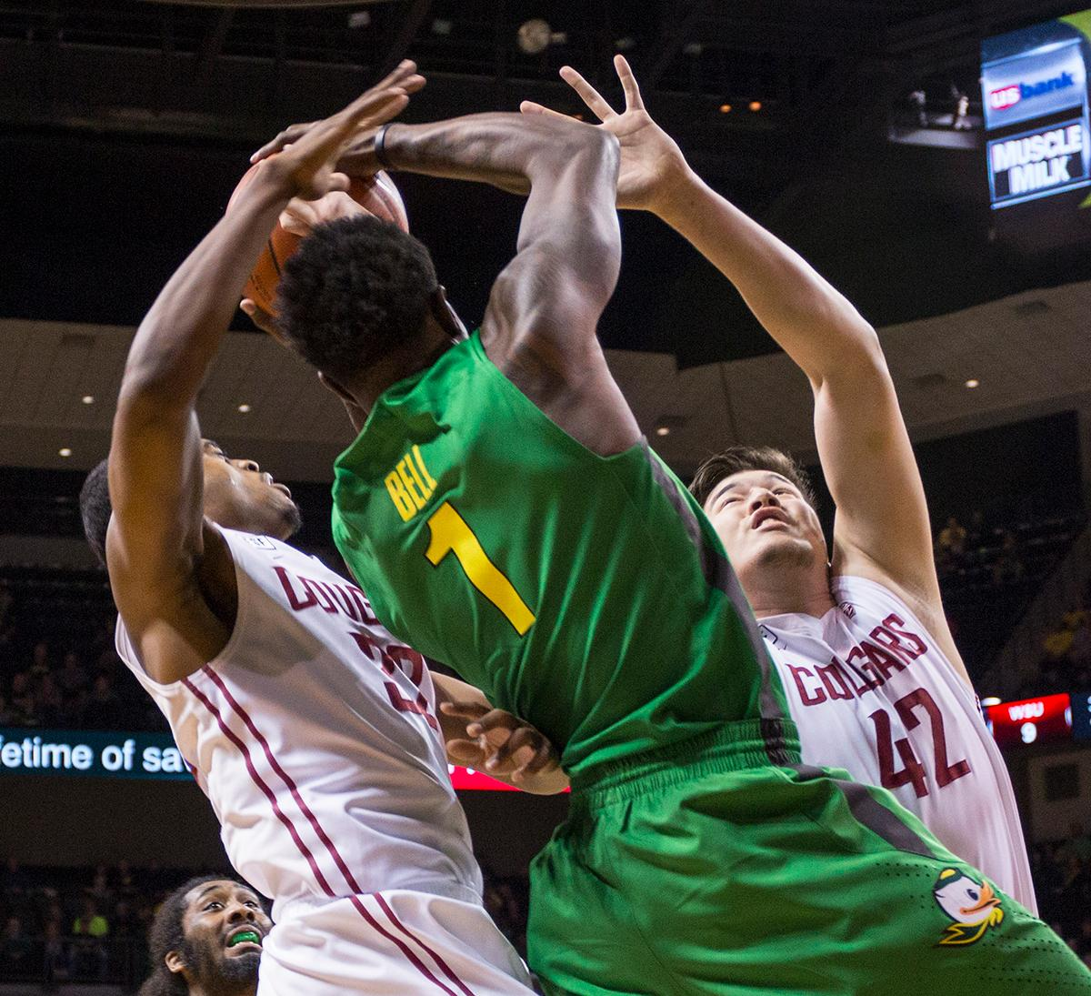 Oregon Ducks' Jordan Bell (#1) fights for the ball against Washington State Cougars' Que Johnson (#32) and Conor Clifford (#42). The Ducks beat the Cougars 76-62. Kianna Cabuco, Oregon News Lab