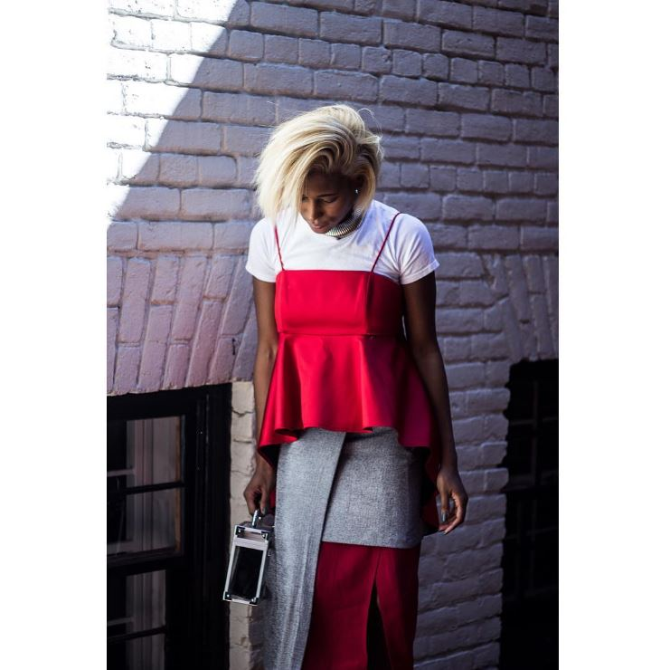 IMAGE: IG user @krystinhargrove / POST: Spring layering = Throw a whole bunch of shit on like your sons undershirt, a #thrifted red skirt & lucite bag, and a Zara top and skirt to finish it off. Yes, two skirts are better than one! Oh, and my hair is poppin (Photo by @crystalaegeanb)