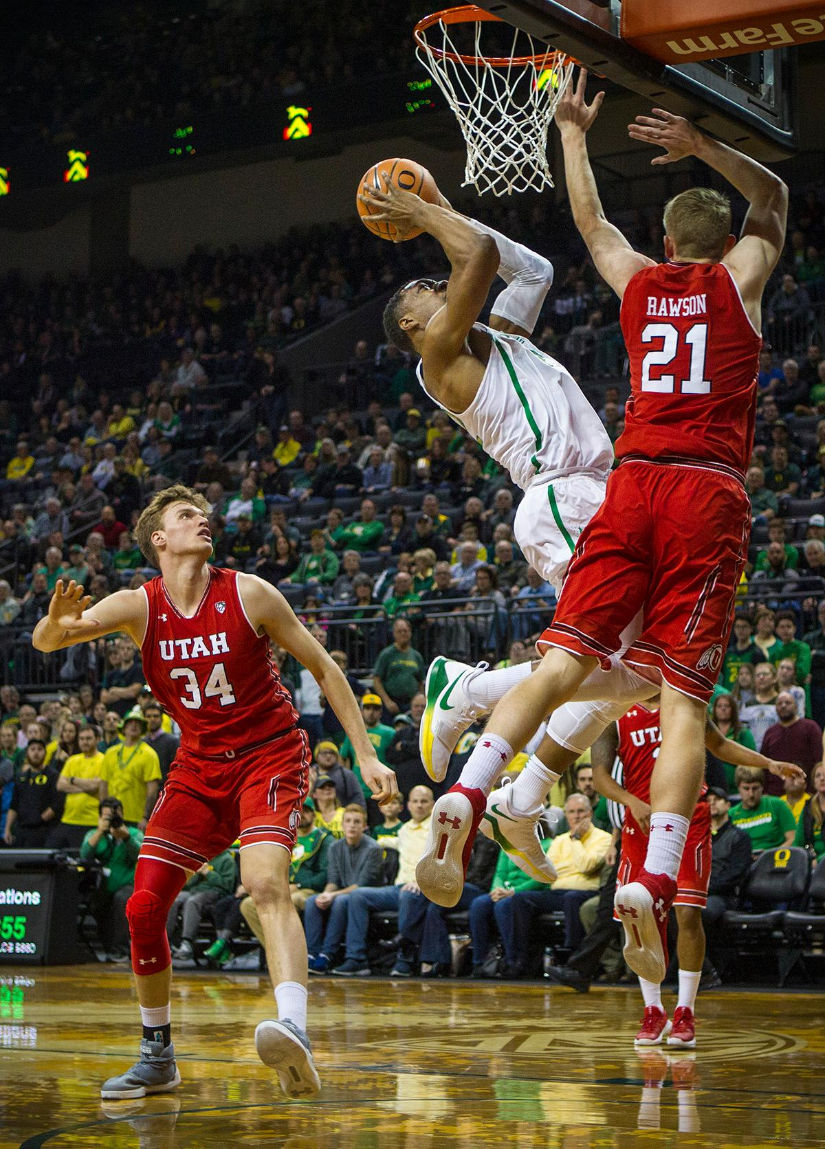 Oregon Ducks Elijah Brown (#5) aims for the basket. The Utah Utes defeated the Oregon Ducks 66-56 on Friday night at Matthew Knight Arena. This is the first Pac-12 conference game loss at home for the Ducks since January of 2015. This also ended the five home game winning streak for the Ducks against the Utah Utes. Photo by Rhianna Gelhart, Oregon News Lab