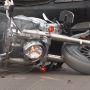 One injured after a car strikes a motorcycle on the Veteran's Memorial Bridge
